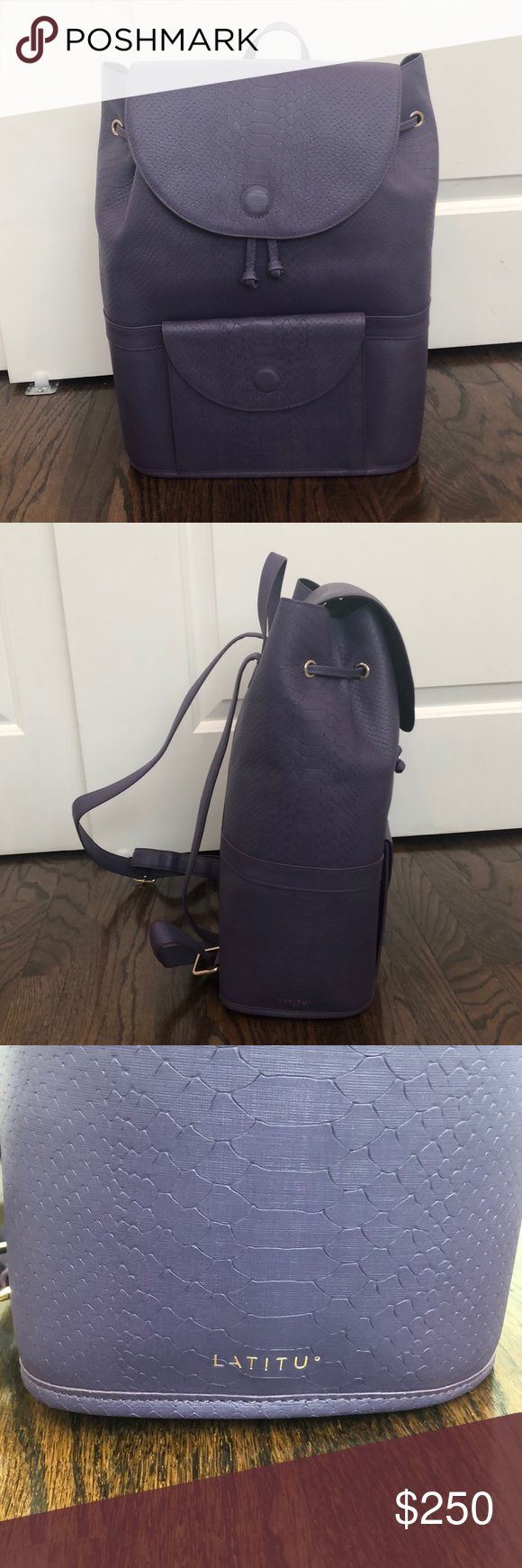 """New Latitu Purple Leather Backpack Brand new, never worn luxury brand Latitu Royal Purple City Backpack. 13""""L x 6.5""""W x 16""""H. 100% italian leather bucket style with magnetic closures and added security of adjustable straps. Cushioned straps rest comfortable. Features exterior front pocket and interior zippered pocket. Reinforced base prevents bag sag. 4"""" top handle, strap maximum is 39 inches. Crocodile embossed leather. Enough room for laptop, camera and essentials. latitu Bags Backpacks"""