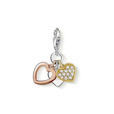 """Charm pendant """"LOVE"""" with lobster clasp 925 Sterling silver; 18K yellow and rosé gold plated white syn. zirconia-pavé This tri-colour heart Charm with its magical syn. pavé zirconia is as diverse as love itself. The silver heart is engraved with """"Love"""". Size: 1.6 cm"""