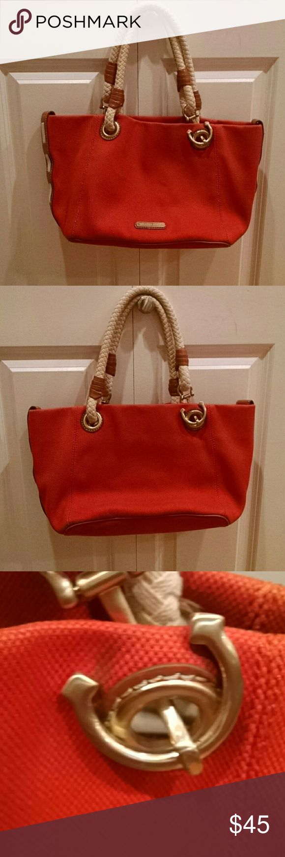 Michael kors orange nautical bag Beautiful bag!!!! Only one spot by the anchor in the front otherwise outside no other marks. Pink highlighter marks on inside. Great summer bag!!! Michael Kors Bags Totes