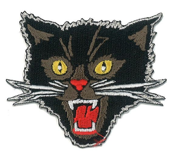 This is an iron-on Back Patch Featuring a close-up mugshot of the pissed off, knife wielding Black Cat patch, also sold in the psycho swami store!