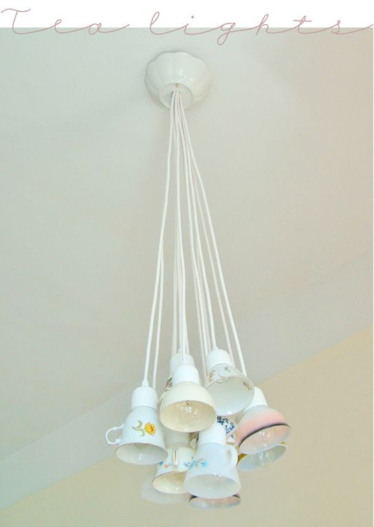 Teacups, but drill thru plate & cup & use as bulb covers on chandelier. Table lamp - upright like a bunch of open flowers in a vase. Or upside down on a ring, with tea or kitchen accessories strung upward to a central point like crystals.