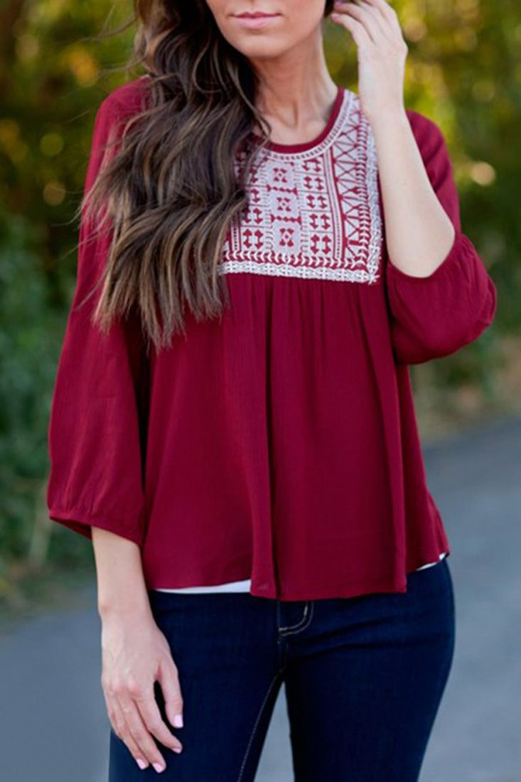 The blouse featuring printed and lace paneled. O neck. Three quarter sleeves.