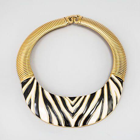 Givenchy (FR), gold tone metal with an enamel zebra pattern. #france   peculiarjewelry.com x bukowskis