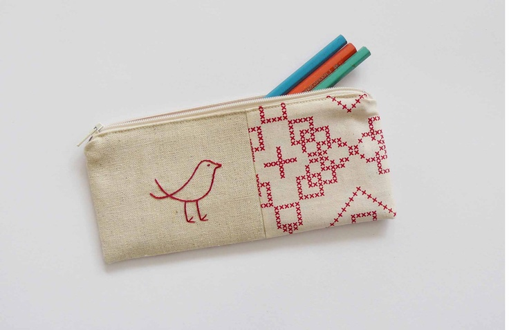 pencil case with red bird embroidery. cross stitch patterned taupe fabric.