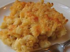 Make a rue with 2 tbsp of butter and 2 tbsp of flour. Melt. Add 2 cups of milk. Once warm, add 2 cups of cheese for mac and cheese, also add about a 1/2 bag of any kind of cheese. Melt in the sauce. Then season the sauce with garlic, salt and pepper. Pour over cooked pasta in a casserole dish. Top with bread crumbs and sprinkle some shreaded cheese on top. Bake on 350 for about a 1/2 hour.