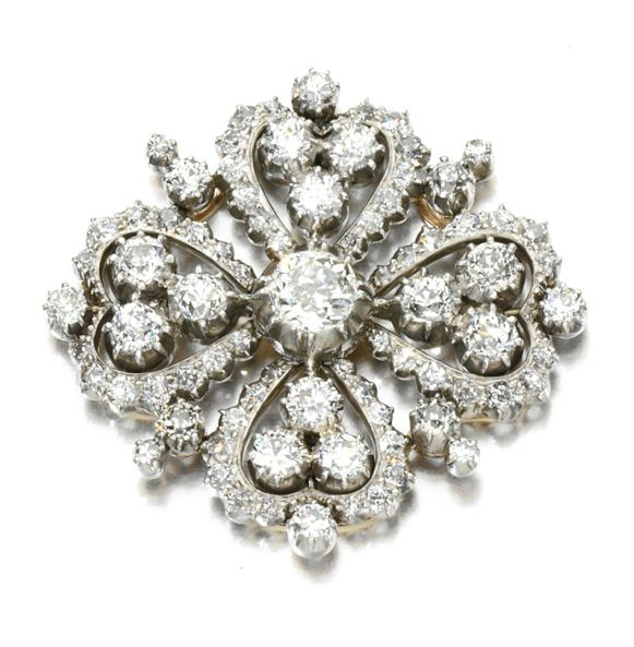 DIAMOND BROOCH, 1880S Of quatrefoil design set with cushion-shaped and circular-cut diamonds, detachable brooch pin.