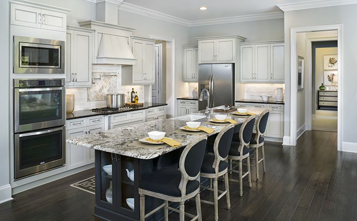 The gourmet kitchen offers an island with bar seating and for Gourmet kitchen island