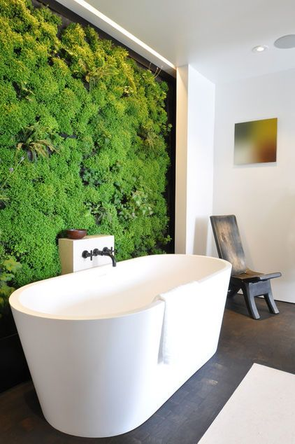 "contemporary bathroom by Janet Paik; A living wall in the main bath — which Kevin Hackett and Jessica Weigley designed as a ""healing wall"" — holds a lush assortment of herbs, geraniums and mosses. A watering system trickles down the wall to keep the fragrant bursts of mint and lavender fresh. MUST HAVE!!!"