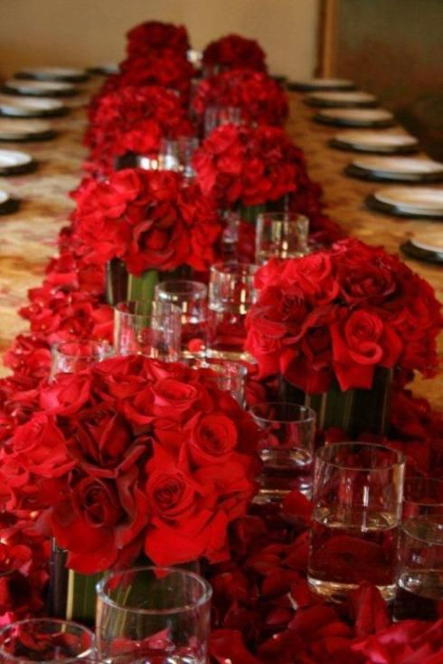 A sea of red roses for dramatic table setting