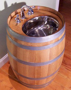 Barrel Sink. Too cute! I have an old weathered barrel like this and keep hoping the NATHAN will make this for our indoor outhouse bathroom. It would be perfect in there.