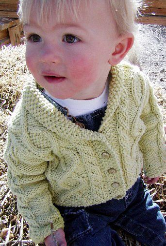 I wanted a baby sweater design to wow the mommies but a pattern that was easy to memorize and execute for myself. Living in a wintry clime, my thoughts are crowded with springtime wishes, so the garden was a constant inspiration for my design; trellis cables and seed stitch borders. by Britta Stolfus Rueschhoff. Find the free baby knitting pattern here: link