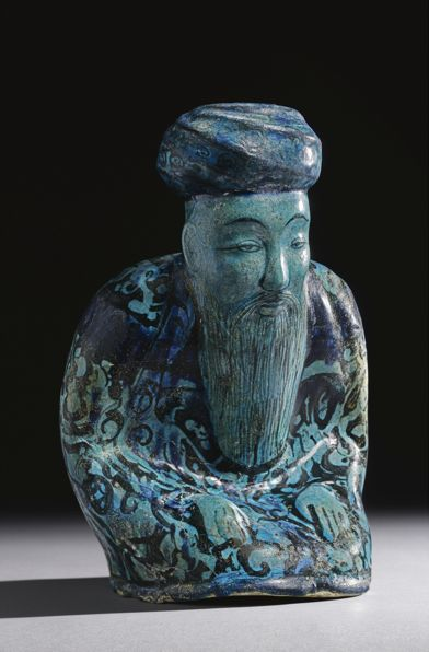 A Large Kashan Turquoise Pottery Figurine of a Seated Man, Persia, 12th/13th Century