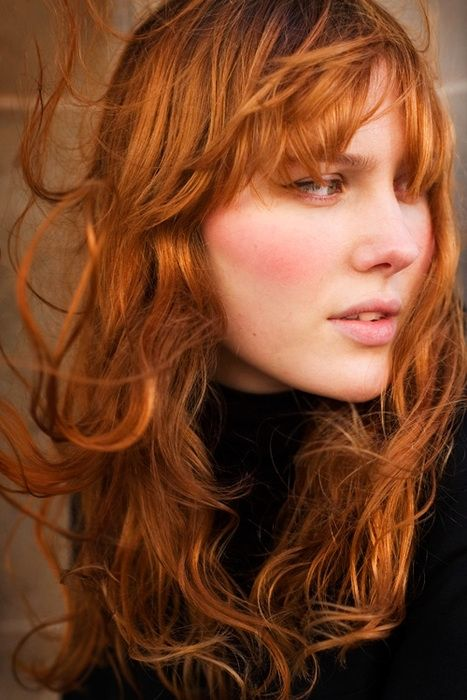 wondering: if i get fringe bangs, will they be windswept like this because my hair is curly?