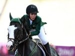 Dalma Rushdi Malhas of Saudi Arabia rides on the horse Flash Top Hat at the 2010 Youth Olympic Games in Singapore