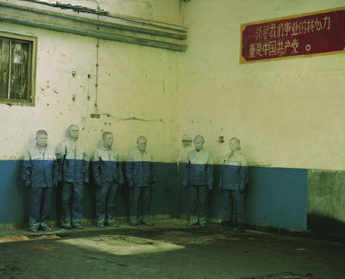 Liu Bolin, Chinese artist. Usually he hides in the picture. For this one he asked workers to take place in front of their now closed factory's walls. Powerful.