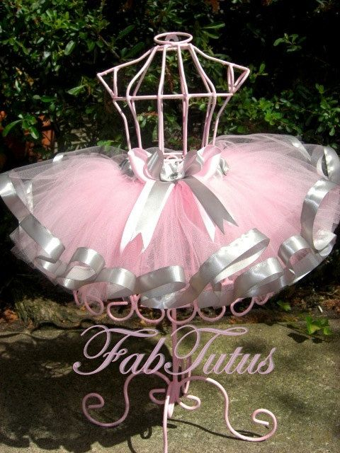 Light pink tutu with silver gray satin ribbon trim by FabTutus, all sizes and color combinations available. $55.00, via Etsy.