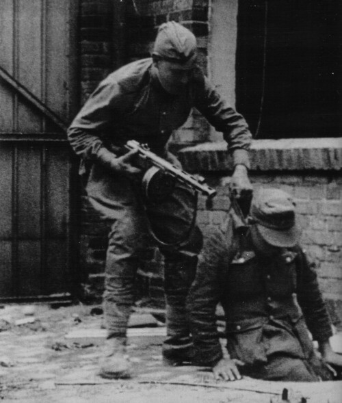 Red Army soldier captures a German soldier during the Battle for Berlin, May 1945: