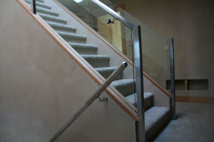 Interior glass railing with S.S. handrail and posts.
