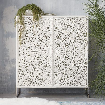 This beautiful cabinet is hand-crafted by Indonesian artisans using traditional furniture-building techniques.