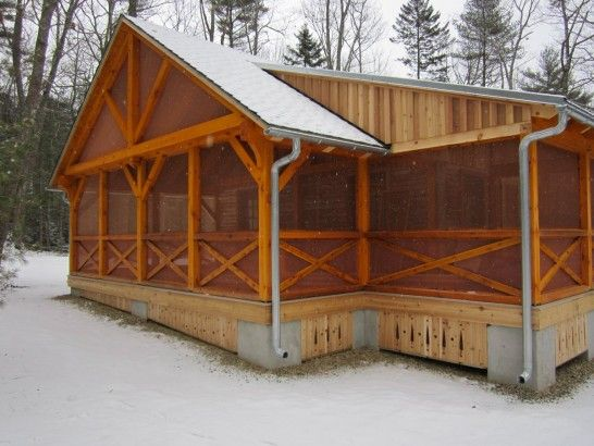 This timber frame screen porch transformed this rustic for Timber frame screened porch