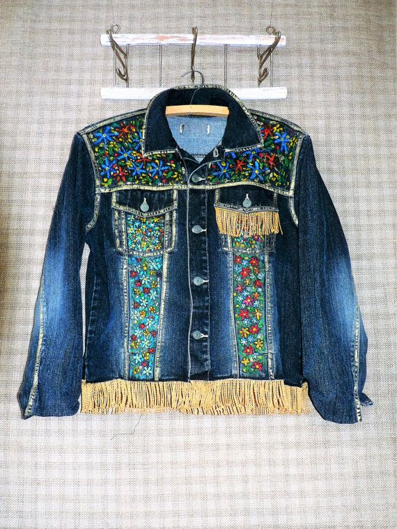Handpainted recycled denim jacket with fringe. One of a kind. Length - 23,5 in/ 60 cm Length sleeves - 23 in / 58 cm Width bust - 40 in/ 102 cm Width hips - 38 in/ 97 cm