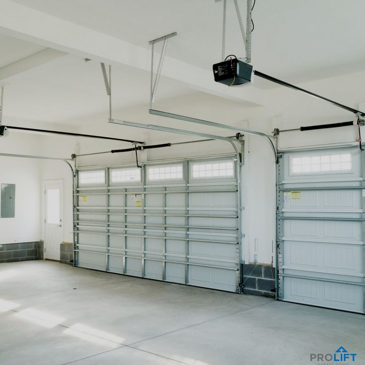 The inside view of a garage door is not nearly as interesting as the outside view; however, the inner workings are really important! Every garage door is heavy and works hard each and every time it goes up-and-down. So when it comes to your garage door, it's best to have an annual safety inspection and tune-up as well as necessary repairs or full replacement when the time comes. Make time for maintenance! | Illustrative photo: Shutterstock | Pro Lift Garage Doors St. Louis | Houzz