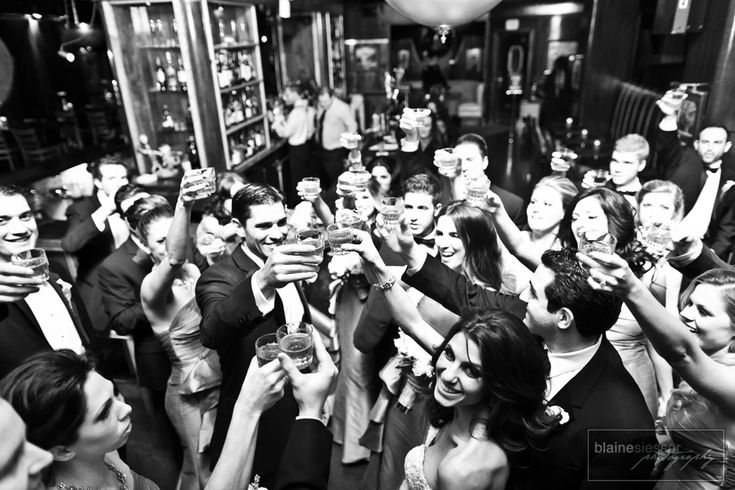 Photo op- all the friends cheers to bride and groom
