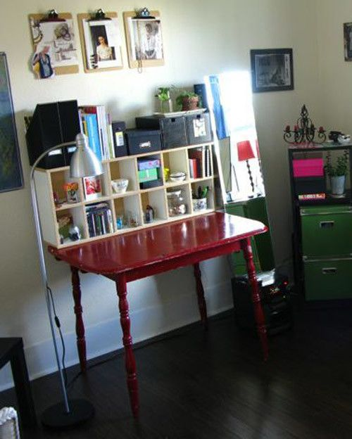 """craftscafeonetsy repurposed an old Ikea CD tower into a storage shelf for current jewelry projects, inspirational images, tools, shipping supplies, and books. As extra motivation, she keeps photos of her grandparents taken in the 1940s on the walls. """"I like to look at the dresses my grandmothers are wearing and remember that they made them themselves!"""""""