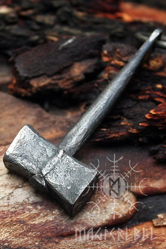 "This is a forged iron handmade Viking style pendant. The pendant is a mini replica of an ancient Nordic hunting hammer tool. Style is unisex, looks good on both men and women.  Hammer length is about 1.85"" inches or 48 mm. Pendant comes on a black leather necklace and is coated by a water resistant finish to protect from rusting.  #magicrebel #forged #iron #handmade #vikings #thor #hammer #hunting #tool #pendant #necklace"