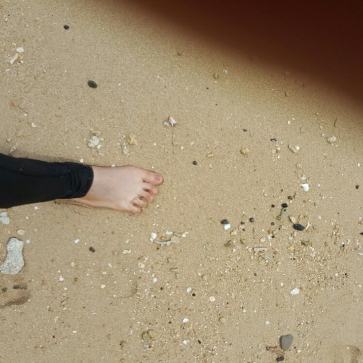 Feet soaked in the sand#white sand beaches