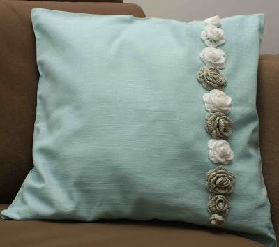 Mint pillow with crochet roses