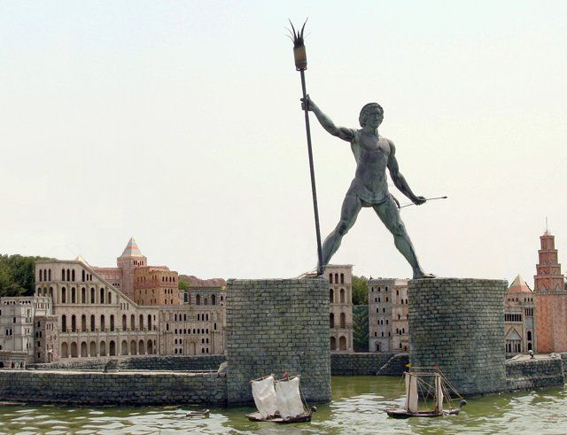 Built between 292 and 280 BC, the Colossus of Rhodes was a giant statue of the Greek god Helios, erected in the city of Rhodes. The Colossus was made of bronze and iron and stood over 30 meters (107 ft) high, making it one of the tallest statues of the ancient world. It was the last of the seven wonders to be completed but the first to be destroyed, by an earthquake in 226 BC.