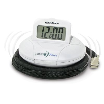 Model: SBP100   Sonic Shaker™ Information  Small, light-weight, self-contained and battery-operated, this is a travel alarm that you can count on. It comes complete with batteries, pillow strap and clasp, and protective travel case. The SBP100 is small enough to fit in the palm of your hand, but packs a pretty big wake-up punch! Sleep well knowing you'll wake up on time, even when you're on the road.