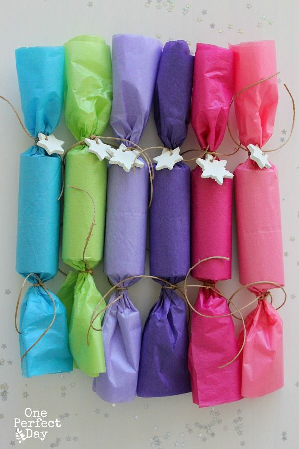 DIY Christmas Crackers - I love the fruity colors. These look really simple to make.