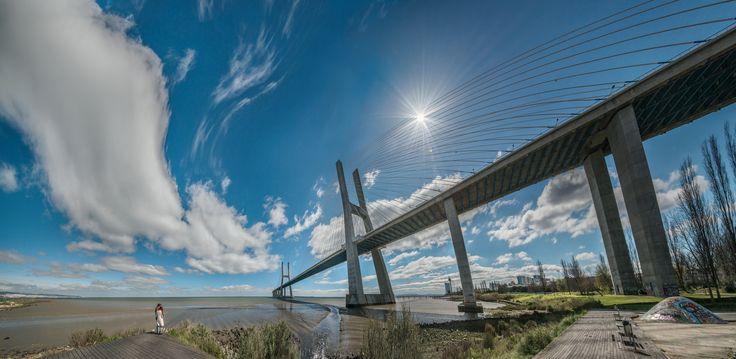 https://flic.kr/p/H4N11K   Wish upon the falling sky   Vasco da Gama Bridge and the river Tagus - Parque das Nações, Lisbon [panorama merged using rectilinear perspective]