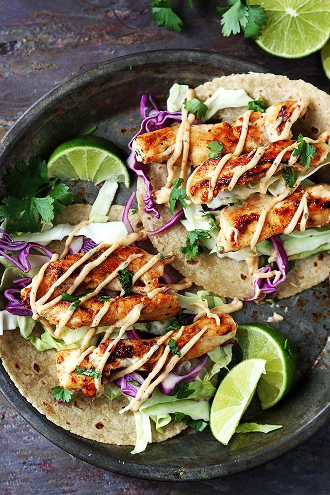 Grilled Jerk Chicken Tacos with Cabbage Slaw, Cayenne Paprika Mayo and Lime. This, I have to try. Looks really good