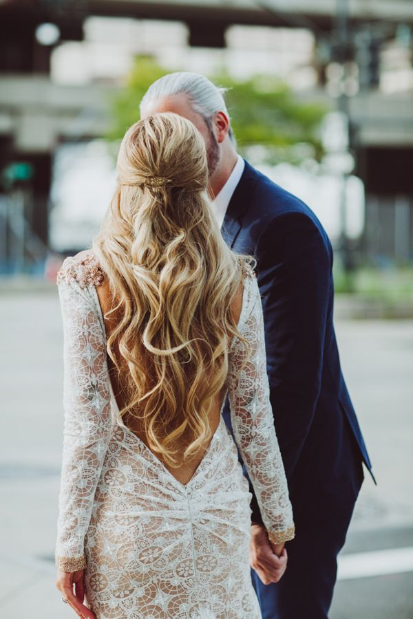 long waves and low back wedding gown - photo by Amber Gress http://ruffledblog.com/stylish-manhattan-wedding/