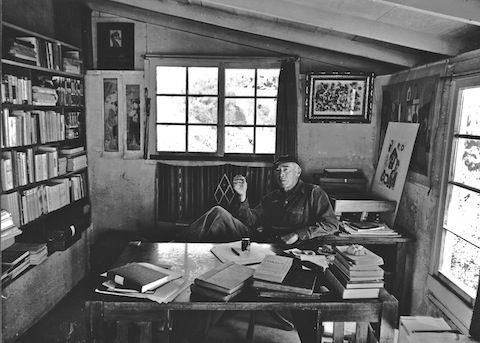 Henry Miller in his home library in Big Sur, uncredited