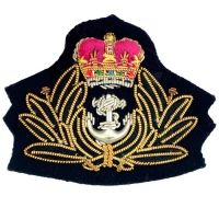 Army Officer's cap badges are gold and silver bullion wire embroidered. Hud Badges make Navy Cap Badges, Crown and Star badges in sew on variety and with Velcro backing. http://hudbadges.com/products/cap_badges