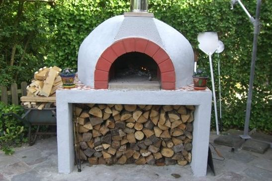 Original Italian wood fired Fornino pizza oven or Mediterranean brick oven aka pizzaoven including huge wood storage compartment