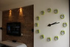 empty wall in living room - wall clocks