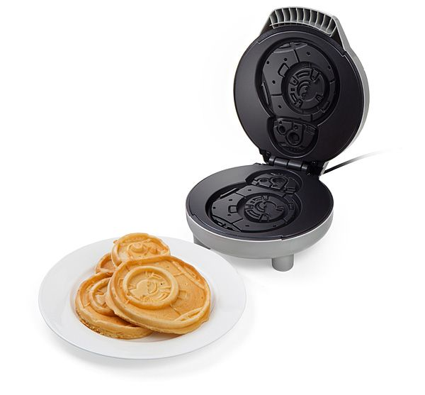 Let this Star Wars BB-8 Waffle Maker bring a galaxy far, far away to your breakfast table each morning. Its non-stick cooking plates duplicate BB-8's design on both sides, and red and green lights indicate when the appliance is ready.