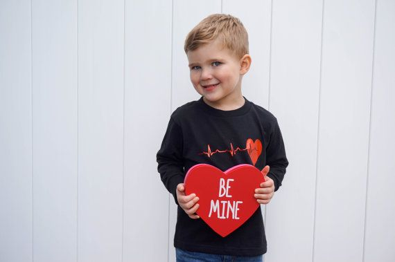 Toddler Valentines Shirt Toddler Boy Valentine Shirt Baby    Looking for an amazing gender neutral Valentine's Day shirt for your little lady or dapper dude?! Something subtle and unique yet still perfect for the occasion? Well look no further! Shiny red heart beat is professionally heat pressed to super soft black short or long sleeve shirt or bodysuit!    100% Cotton bodysuits or shirts! Short Sleeve and Long Sleeve Available! Black shirt only.