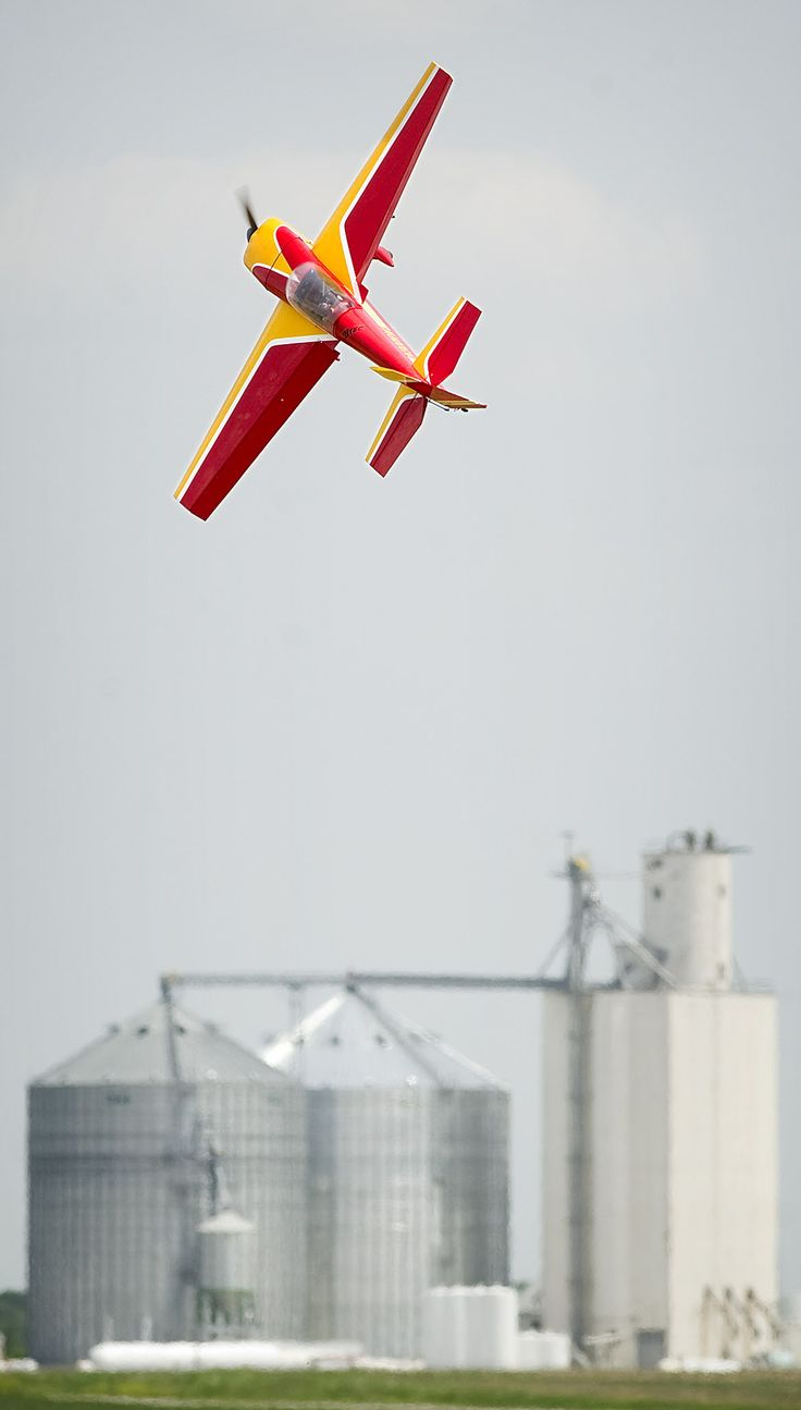 An Extra 300 controlled by Casey Vohnout of Omaha does acrobatic flips Thursday during the second annual CornHuckFest, a festival for radio-controlled planes hosted by the Lincoln Sky Knights RC Club.