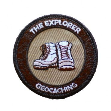 """7SofA Patch: The Explorer $4.00 USD  Every day, there's a new adventure out there- and you can't wait to find it. For every geocache you find, you earn two smileys: the one on your profile and the one on your face.  If this sounds like you or someone you know, celebrate with this cool Explorer patch!  Find a Traditional geocache to earn the Explorer souvenir.  Size: 2.5"""" (6.3cm) in diameter"""