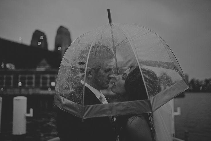 Wet weather wedding photo. Clear umbrellas for wedding photos. Image: Cavanagh Photography http://cavanaghphotography.com.au