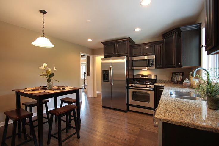 Remodeled Kitchen with new flooring, new granite counter tops, new cabinets, and all new appliances!