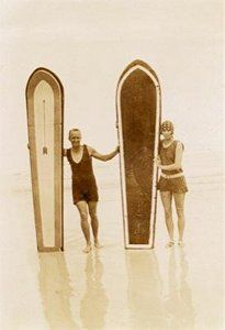 Heather Price with surfboard and US marine at Muizenberg Beach, Cape Town c. end of WW1.