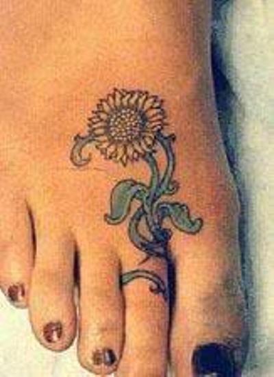 Sunflower Toe Ring Tattoo.
