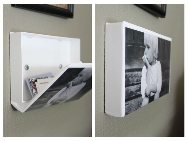 Cool picture frame & hidden storage!  Just use an old VHS case--you can paint or cover the sides & back. Then slide your picture under the plastic cover and mount to the wall.